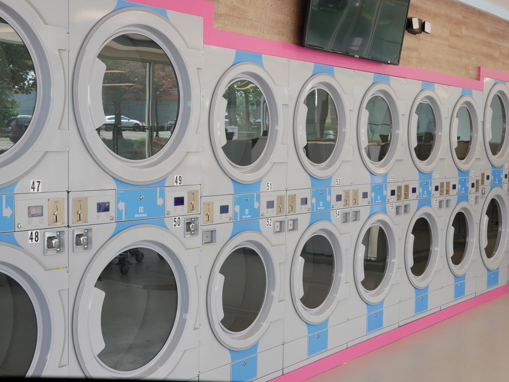 Homepage header image for The Laundry Room, Charlotte's best laundromat. Located on Arrowood Road, our store also offers dry cleaning, wash-and-fold, and laundry delivery services. Visit us today!